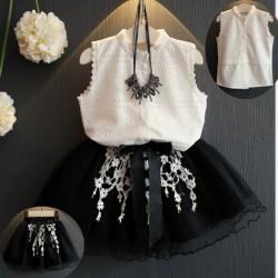 V2088 - Bộ váy gồm áo trắng sát nách kèm chân váy đen hoa trắng cho bé 2,5t - 6t (13kg - 23kg)