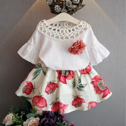 V2056 Áo trắng vai đan lưới kèm chân váy hoa cho bé 2,5t - 8t (13kg - 27kg)