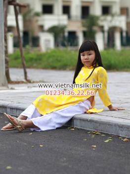 Áo dài gấm Thái Tuấn cho bé gái màu vàng đồng xu nhỏ GTT.6