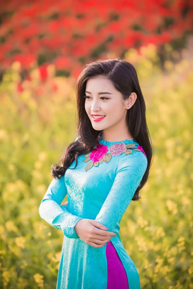 Vải may áo dài lụa tơ tằm họa tiết hoa cúc xanh ngọc đậm.VL.C122