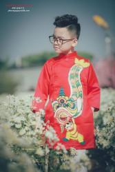 Áo dài vẽ em bé múa lân cho bé trai