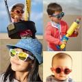 Kính râm chống tia UV cho bé từ 4 - 14 tuổi (gọng chấm bi đỏ)